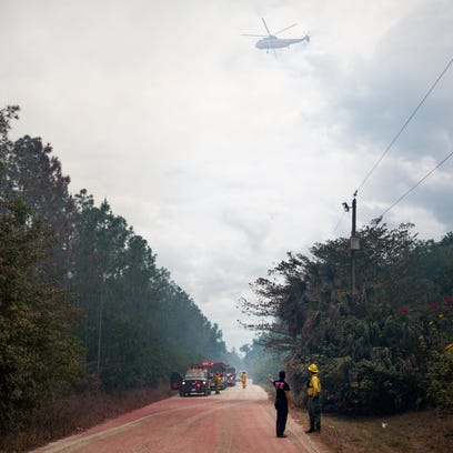 Fire Rescue teams work to keep the fire from spreading