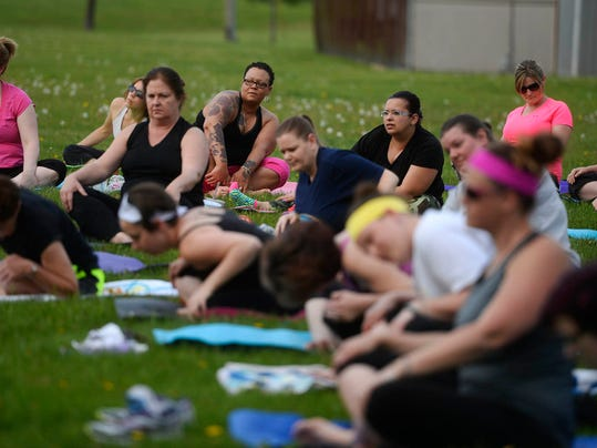 """About 100 people attended the first No Sweat in the Park of the summer at the York Daily Record/Sunday News in West Manchester Township Tuesday, May 5, 2015. Megan Donley from Lotus Moon Yoga lead the first class. Classes will continue throughout the summer each Tuesday night 6-7pm. For updates and details visit www.yorkblog.com/nosweat.  Kate Penn â """" Daily Record/Sunday News"""