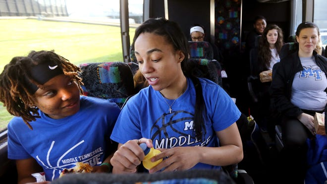 MTSU Women's Ty Petty, left, and Brea Edwards, right, eat breakfast on the bus with their teammates on, Thursday March 16, 2016, before the heading to the NCAA Tournament, where they will play Florida State in Texas.
