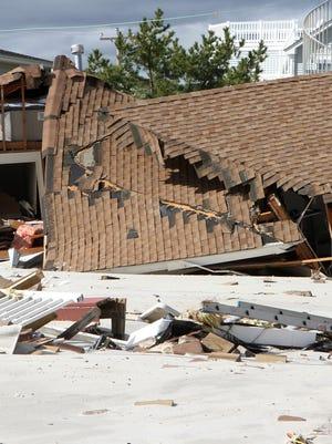 A house in the Holgate section of Long Beach Township damaged by superstorm Sandy.