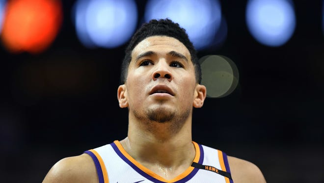 Oct 25, 2017; Phoenix, AZ, USA; Phoenix Suns guard Devin Booker (1) looks up the court in the game against the Utah Jazz at Talking Stick Resort Arena. Mandatory Credit: Jennifer Stewart-USA TODAY Sports