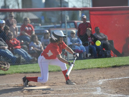 Ni'Georia Floyd lays down a bunt against Carey.