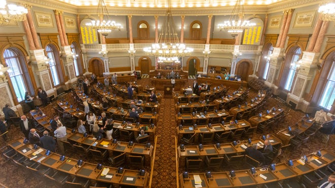 Members of the Kansas House of Representatives gather on the final day of the 2020 legislative session.