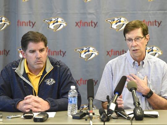Predators coach Peter Laviolette, left, and general