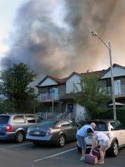 Residents of The Hearthwood At North Brunswick condominium cevelopment evacuate their homes as the fire continues to burn.