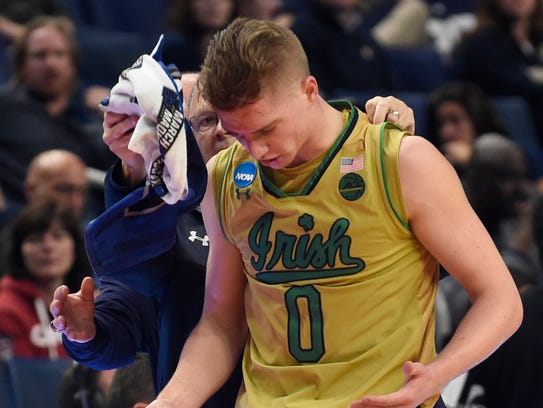 Notre Dame's Rex Pflueger suffered a cut on his head