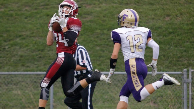 Treyvin Groesser, left, and top-ranked Portland will face defending state champion and No. 6 Grand Rapids West Catholic in a Division 5 district final next week.