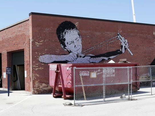 The Sling Shot Boy public art as seen on the Sheboygan