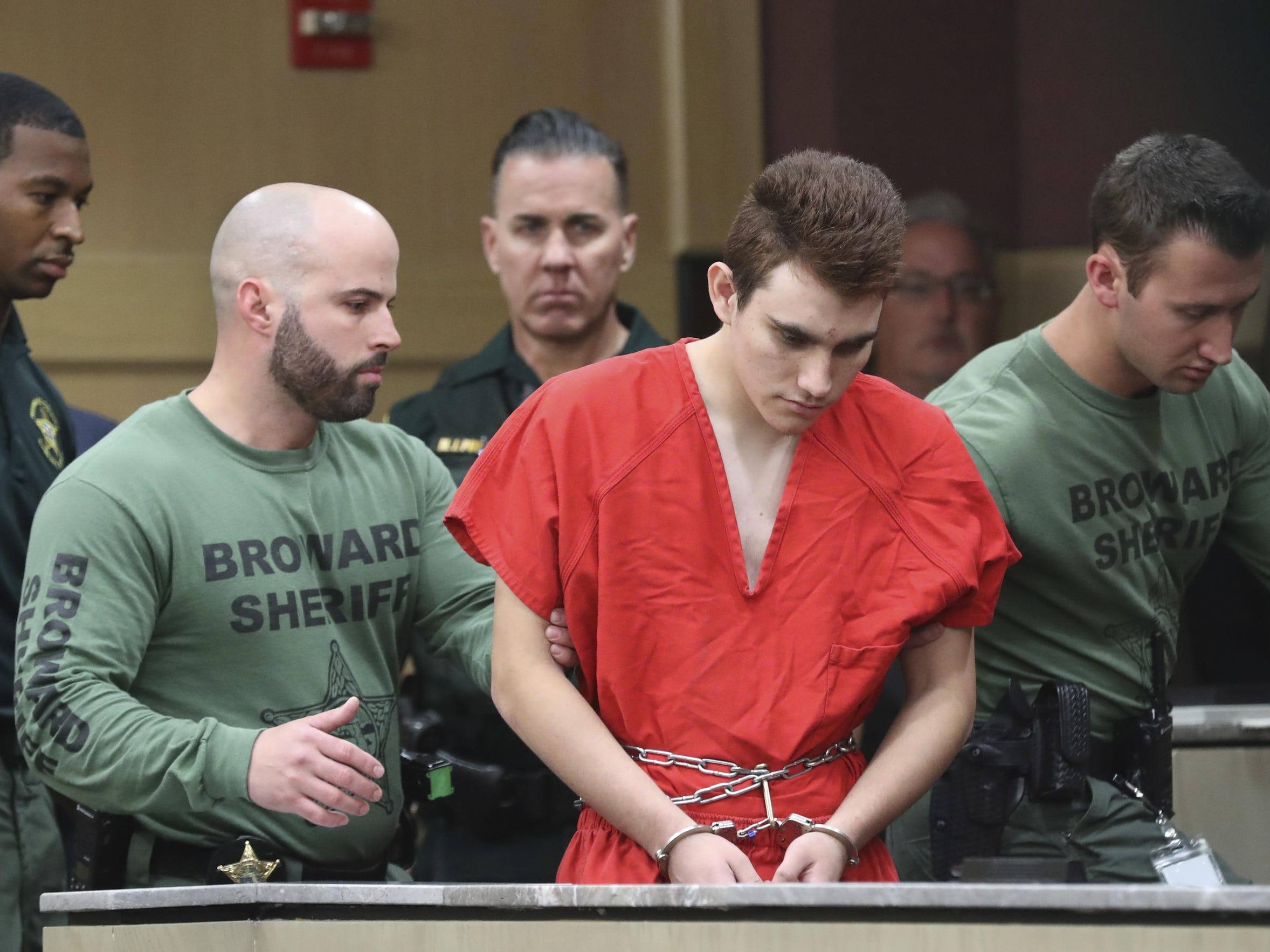 Nikolas Cruz is led into the courtroom before being arraigned at the Broward County Courthouse in Fort Lauderdale, Fla., on Wednesday, March 14, 2018. Cruz is accused of opening fire at Marjory Stoneman Douglas High School in Parkland, Fla., Feb. 14, killing 17 students and adults.