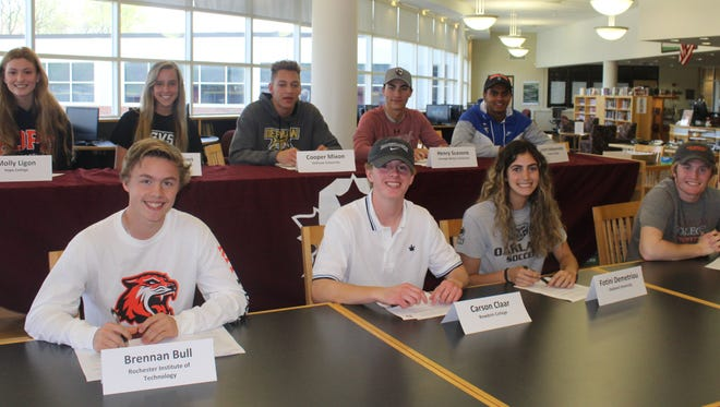A national letter of intent signing ceremony held Tuesday inside Birmingham Seaholm's Media Center involved nine student-athletes.