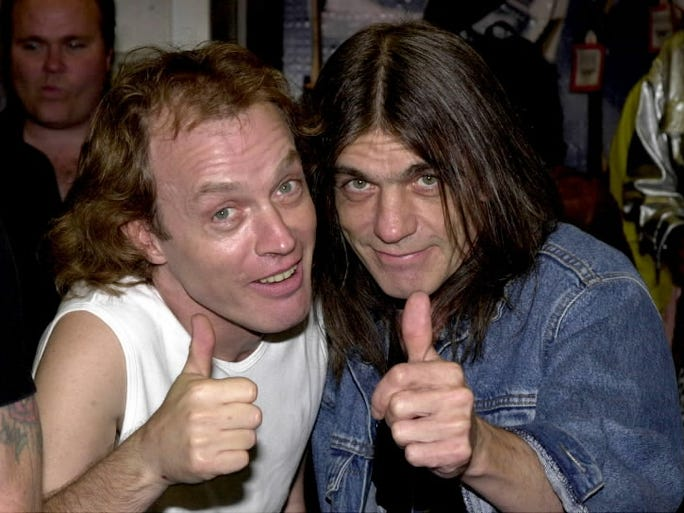 AC/DC posted on their website Wednesday confirming rumors that guitarist Malcolm Young is ill and will have to take a break from the band. They also dismissed rumors that they're retiring from music. Brothers Angus, left, and Malcolm Young co-founded the band in 1973 and have been playing together ever since.  Here, they give a thumbs up at the 2000  Rock Walk handprint ceremony   in Hollywood, Calif.