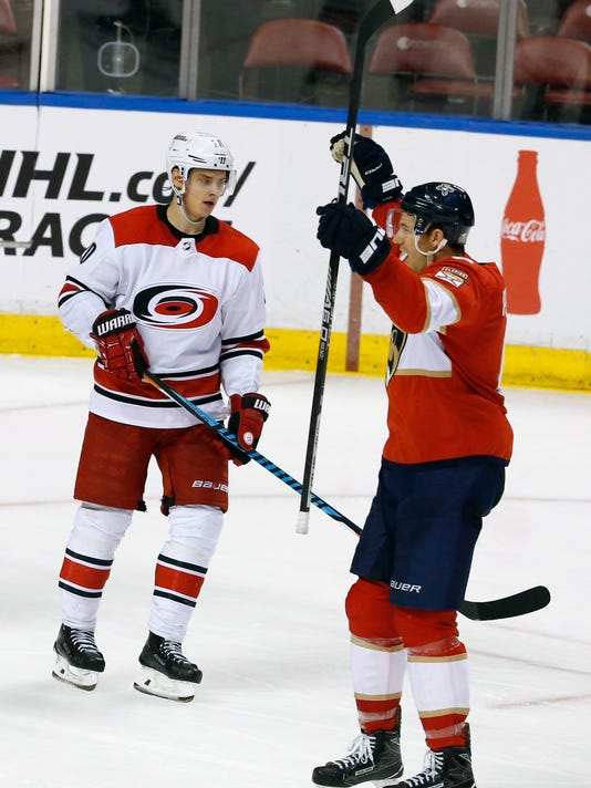 sports shoes 26f77 3ffd0 Petrovic scores in 3rd period, Panthers beat Hurricanes 3-2