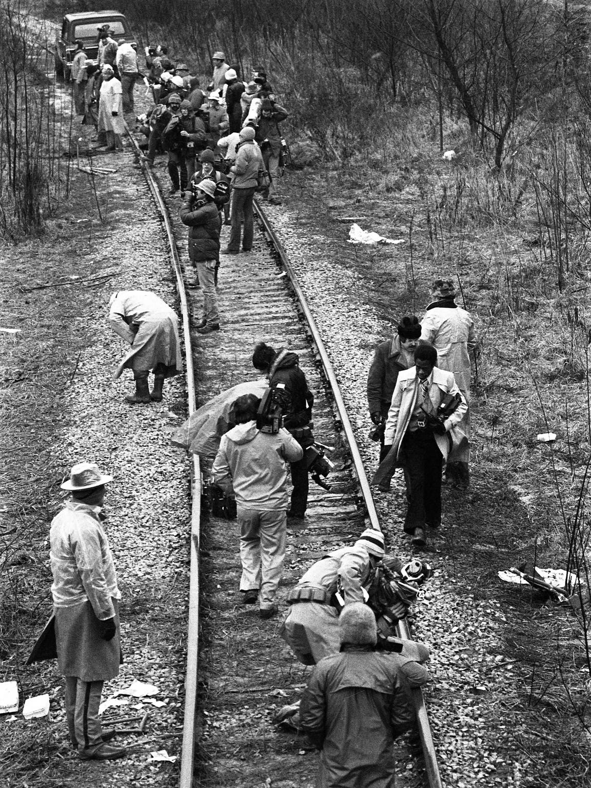 On December 13, 1977, the University of Evansville men's basketball team, coaches/staff, and fans, boarded a chartered DC-3 plane. Ninety seconds after take-off the plane crashed, killing everyone on board. The site of the crash was a hilly area, with few access roads, but there was a train track nearby. A railroad car was brought to the site, and the victims were transported to a temporary morgue at the C.K. Newsome Center at 100 Walnut St., which was on the train line.