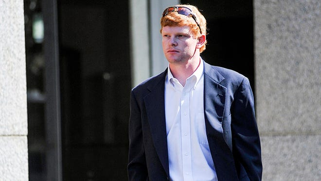 Former University of Mississippi student Graeme Phillip Harris leaves federal court after being sentenced, Thursday, Sept. 17, 2015 in Oxford, Miss. Harris, a former University of Mississippi student who admitted helping place a noose on a statue of a civil rights activist is going to prison. U.S. District Judge Michael P. Mills sentenced Graeme Phillip Harris on Thursday to six months in prison beginning Jan. 4, followed by 12 months' supervised release.