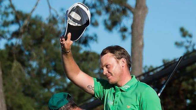 England's Danny Willett celebrates on the 18th green during Round 4 of the 80th Masters Golf Tournament at the Augusta National Golf Club on April 10, 2016, in Augusta, Georgia.