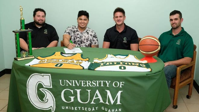 From left, Assistant Coach Josh Torres, Rafael Sablan, UOG Head Coach Brent Tipton, and Assistant Coach Stephen Yates