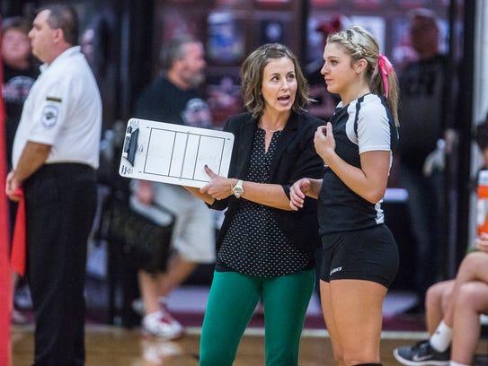 Yorktown coach Stephanie Bloom talks with Kendall Murr