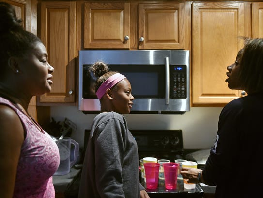Tania Thomas, left, and daughters Trinity, 16, and