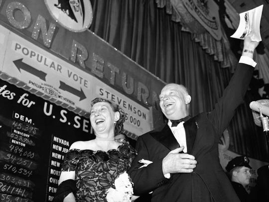 Dwight D. Eisenhower and his wife, Mamie, greet a New