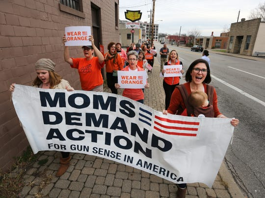 Supporters for Moms Demand Action walk down Hamilton