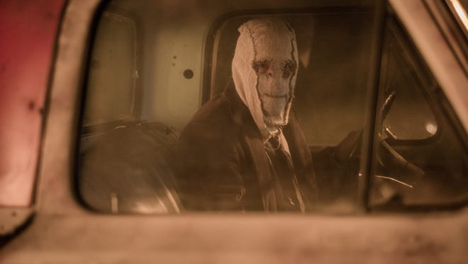 """A masked killer (Damian Maffei) stalks a family in """"The Strangers: Prey at Night."""""""