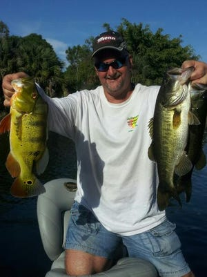 Capt. JoGene Holaway sharing a butterfly peacock bass and a couple largemouth black bass, which he caught using custom colored Bass Addiction Gear Twitch Tails. He release all of the fish alive.