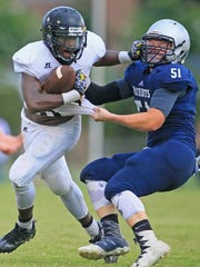 Crescent's Kenny White fends off Powdersville's Maddie Golden during the Anderson County Jamboree at Palmetto High School in Williamston.