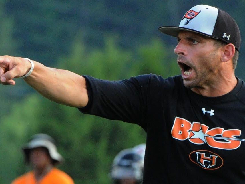 Hoover football coach Josh Niblett and the Bucs won the 2014 Class 7A state championship in Alabama.