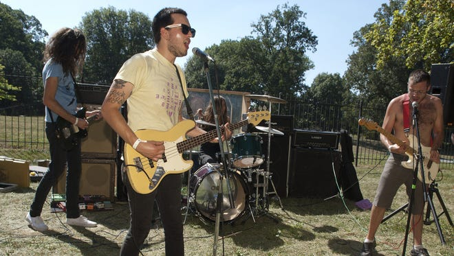 Male Bondage (from left, Charlie Thomas, Jordan Martich, James Lyter and Adam Jones), seen during the 2013 edition of the Cataracts festival, will tour the East Coast with Teenage Strange this month.