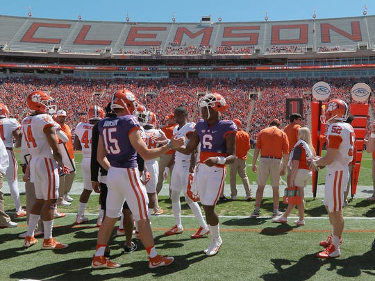 Clemson quarterbacks Hunter Johnson (15) and Zerrick