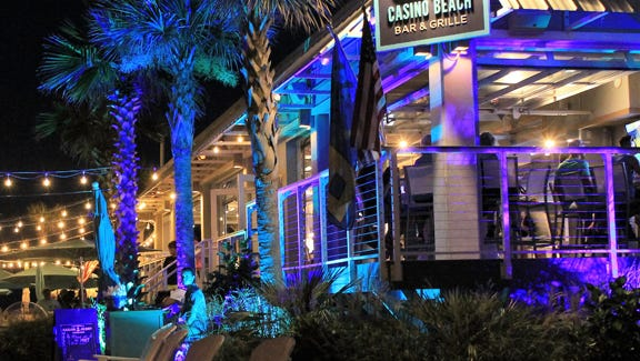 Beautiful by day, Casino Beach Bar & Grille lights up at night for a totally different feel.