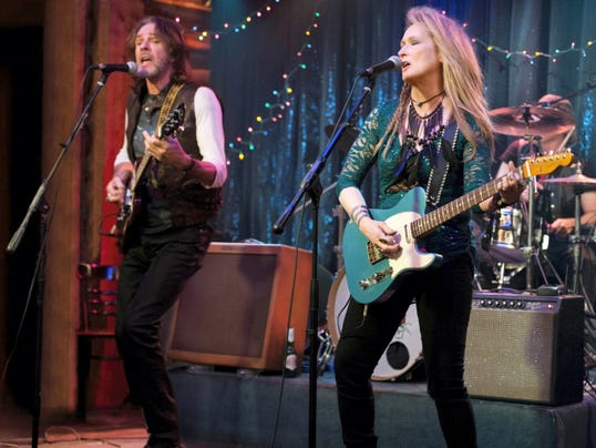"This photo provided by courtesy of Sony Pictures shows, Rick Springfield, left, as Greg and Meryl Streep, as Ricki, performing at the Flash at the Salt Well in TriStar Pictures' ""Ricki and the Flash."" The movie opens in U.S. theaters on Aug. 7, 2015. (Bob Vergara/Sony Pictures via AP)"
