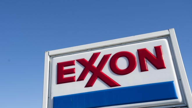 This file photo taken on January 5, 2016 shows an Exxon gas station in Woodbridge, Virginia. ExxonMobil reported a 58 percent drop in fourth-quarter earnings as plunging oil prices dented results in the US oil giant's exploration and production business.