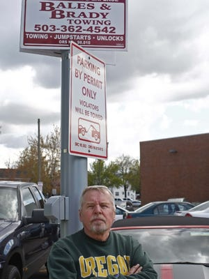 Mike Gaiser, owner of Salem Trophy Company is photographed at the parking lot adjacent to Cinebarre Salem 7 movie theater in April 2013. In January of 2013, his car was towed from the parking lot. He did not realize that the lot was not theater parking.
