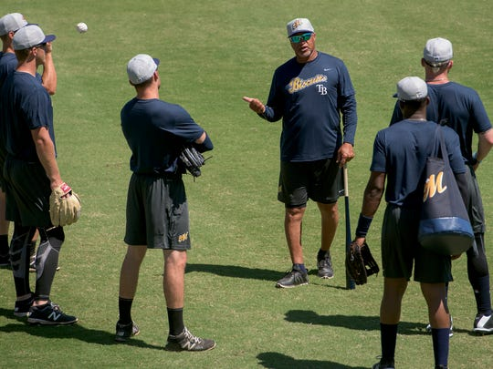 Coach Gary Redus works with outfielders as the Montgomery