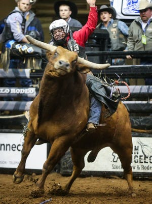 Trey Benton III rides a bull during the 3rd performance of the 85th annual San Angelo Stock Show & Rodeo Saturday, Feb. 4, 2017, at Foster Communication Coliseum.