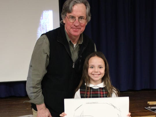 As a kick off to Catholic Schools Week, students at St. Francis Cathedral in Metuchen were visited by New Jersey author and illustrator, Michael Dooling.  Dooling has illustrated more than 65 books and authored five. He is best known for his dramatic and historically accurate illustrations. He is pictured here with third-grader, Emily Mulhearn.