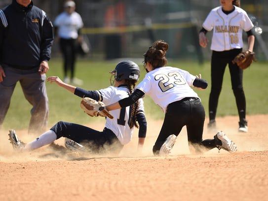 Paramus Catholic and Ramsey softball teams play during