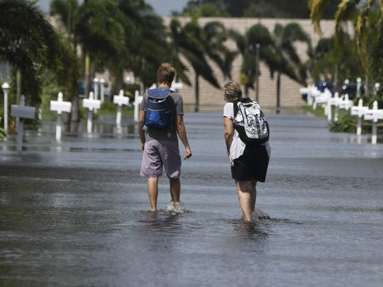 Craig Bailey/FLORIDA TODAY Two people navigate the