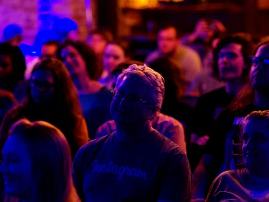 People attend a movie showing at the Scruffy City Hall as part of the Knoxville Public Cinema in Knoxville, Tennessee on Thursday, April 20, 2017.