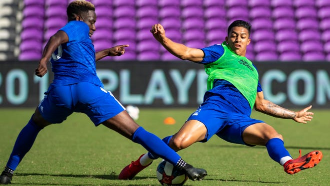 Creighton defender Akeem Ward, left, and Florida International forward Santiago Patino fight for the ball during the MLS combine at Orlando City SC Stadium in Orlando.