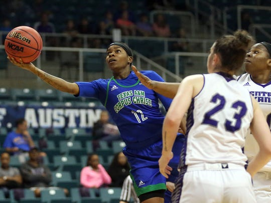 Islanders' Dae Dae Evans lays the ball in against Central Arkansas during the Southland Conference Tournament on Saturday, March 11, 2017, at the Merrell Center in Katy.