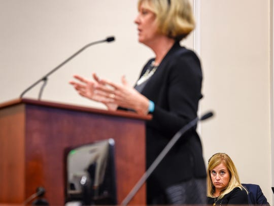 Mayor Megan Barry, right, listens to Mary Cavarra,