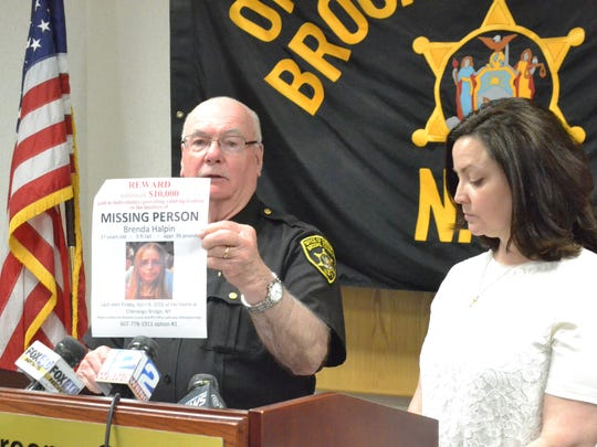 Broome County Sheriff David Harder holds a sign for missing 37-year-old Chenango Bridge resident Brenda Halpin at a news conference in May. Brenda's sister, Endicott resident Susan Papathomopoulos, is at right.