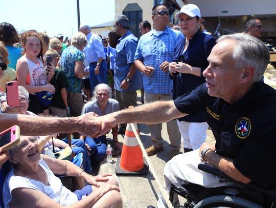 Texas Governor Greg Abbott shakes hands in Rockport,