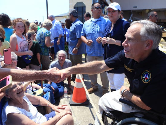 Texas Governor Greg Abbott shakes hands in Rockport, TX at the First Baptist Rockport on Thursday, August 31, 2017. Several secretaries of state and the Vice-President visited Rockport to reaffirm the federal government's promise of help for victims of Hurricane Harvey.