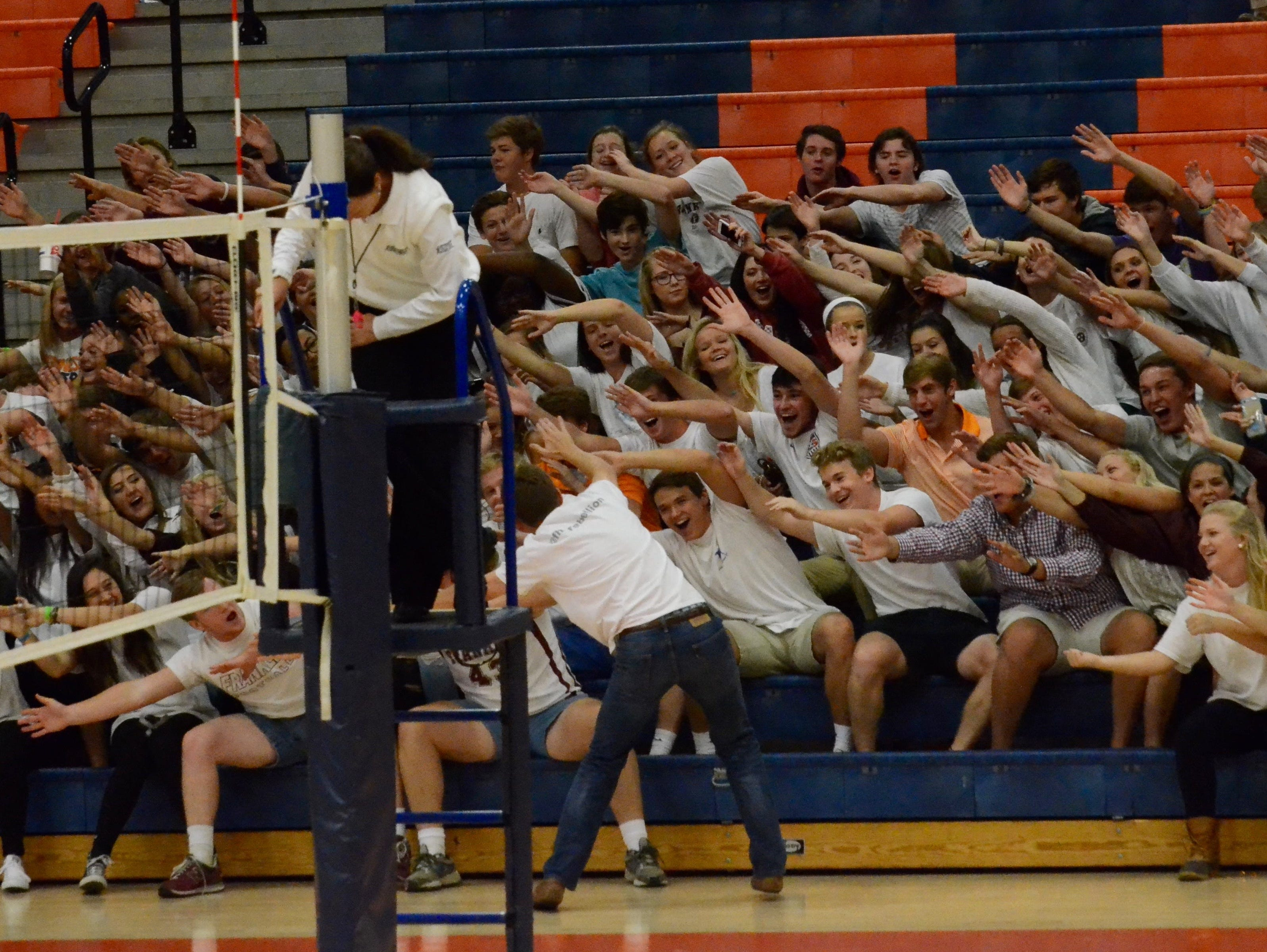 Franklin's student section cheers on the Lady Rebels during Thursday's Class AAA elimination match against Farragut at Blackman High School.
