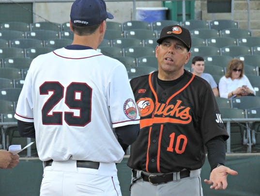 636621527598540724-Patriots-manager-Brett-Jodie-and-Ducks-manager-Kevin-Baez-exchanging-lineup-cards.jpg