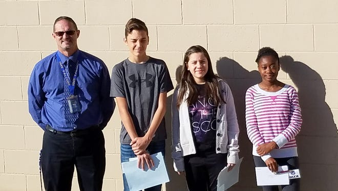 Holloman Middle School pictured left to right: HMS Principal Steven Starkovich, Ethan Ivey, Kaylan Garcia and Bethany Moore.