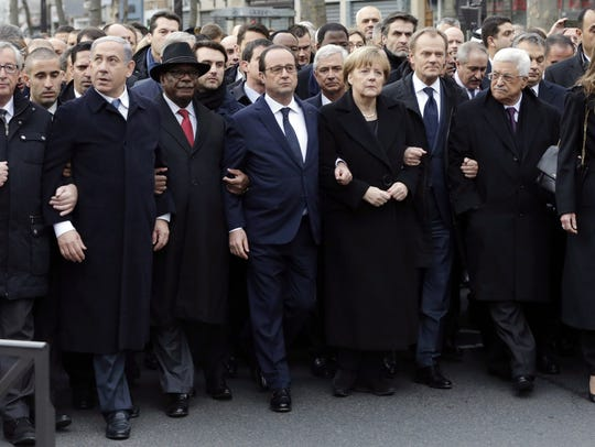 French President Francois Hollande, center, is surrounded